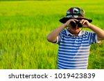 little asian boy with... | Shutterstock . vector #1019423839