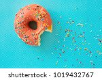 Pink Donut With Colorful Icing...