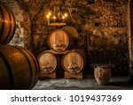 old wooden barrels with wine in ... | Shutterstock . vector #1019437369