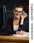 smiling female worker in... | Shutterstock . vector #1019438911