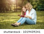 family is reading happily... | Shutterstock . vector #1019439241
