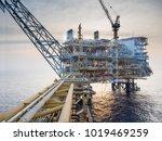 offshore platform in sunset | Shutterstock . vector #1019469259