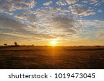 Sunset Over Field In Summer Of...