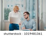 two colleagues monitoring... | Shutterstock . vector #1019481361