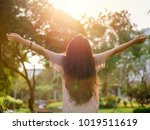young asian woman arms raised... | Shutterstock . vector #1019511619