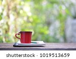 red cup and notebooks at outdoor | Shutterstock . vector #1019513659