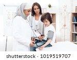A Female Doctor Wearing A Hija...