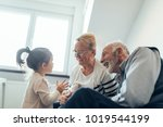 grandparents spending time with ...   Shutterstock . vector #1019544199