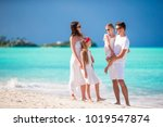 young family on vacation have a ... | Shutterstock . vector #1019547874