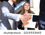 business people shaking hands ...   Shutterstock . vector #1019553445