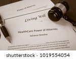 Stock photo healthcare power of attorney living will documents with legal gavel 1019554054