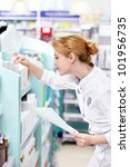 A young pharmacist at the pharmacy - stock photo