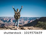 back view of young wanderlust... | Shutterstock . vector #1019570659