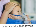 doctor treatment a child who... | Shutterstock . vector #1019587087