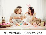 mother  father and daughter are ... | Shutterstock . vector #1019597965