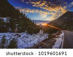sunset at snow covered mount... | Shutterstock . vector #1019601691
