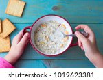 plate with porridge on a wooden ... | Shutterstock . vector #1019623381