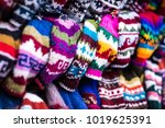 colorful handmade knitted hats... | Shutterstock . vector #1019625391