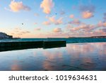 wet granite seafront with... | Shutterstock . vector #1019634631