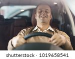 portrait of a happy mature man... | Shutterstock . vector #1019658541