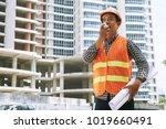 contractor with blueprint using ... | Shutterstock . vector #1019660491