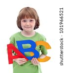 Little school boy holding large colorful letters of abc - stock photo