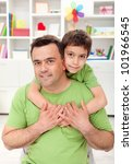 Father and son together at home - portrait - stock photo