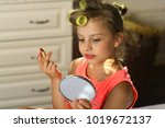 Little Girl With Curlers Wears...