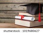 graduation hat and stacks of... | Shutterstock . vector #1019680627