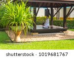 woman in gazebo practicing yoga   Shutterstock . vector #1019681767