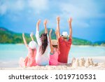 happy family on a beach during... | Shutterstock . vector #1019710531