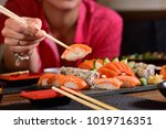 hand holding a chopstick with... | Shutterstock . vector #1019716351