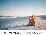 tourist woman sitting on dunes... | Shutterstock . vector #1019722927