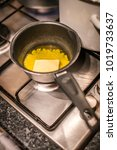 butter melting in frying pan in ... | Shutterstock . vector #1019733637