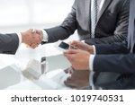 two confident businessmen... | Shutterstock . vector #1019740531