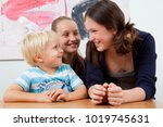 brother and sisters at table | Shutterstock . vector #1019745631