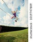 boy jumping off swing in... | Shutterstock . vector #1019747809