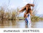 sexy girl in water wearing a... | Shutterstock . vector #1019793331