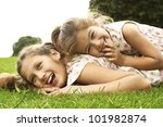 Two Sisters Laughing And...