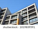 facade of a modern apartment... | Shutterstock . vector #1019839591