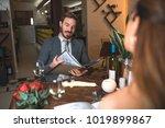 mid adult handsome man looking... | Shutterstock . vector #1019899867