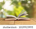 open book on old wooden table | Shutterstock . vector #1019915995