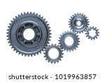 Small photo of Five steel cog wheels from an engine are connected together over a plain white background.