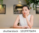 asian woman with bored... | Shutterstock . vector #1019970694