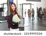 young asian student on campus... | Shutterstock . vector #1019995534