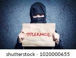 muslim girl in black hijab... | Shutterstock . vector #1020000655
