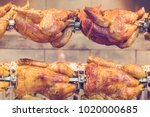 grilled chickens on a spit ... | Shutterstock . vector #1020000685