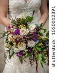 beautiful wedding bouquet in... | Shutterstock . vector #1020012391