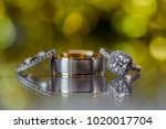 a pair of wedding rings with...   Shutterstock . vector #1020017704