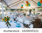 tables set up for a dinner... | Shutterstock . vector #1020035221
